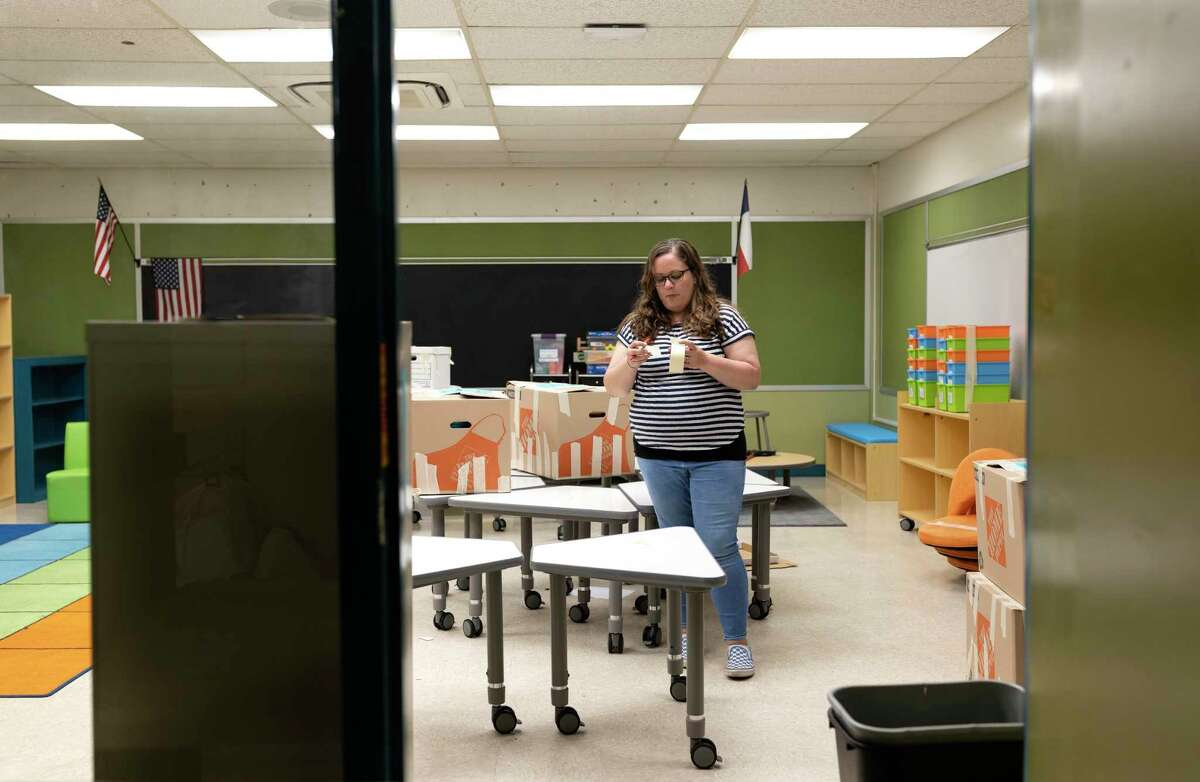 Heather Brown, first grade teacher at Peach Creek Elementary in Splendora, packs her classroom belongings, Monday, May 4, 2020. Gov. Splendora ISD will begin bringing students back to campus on a staggered schedule starting Aug. 17, 2020 with pre-k through first-grade students.