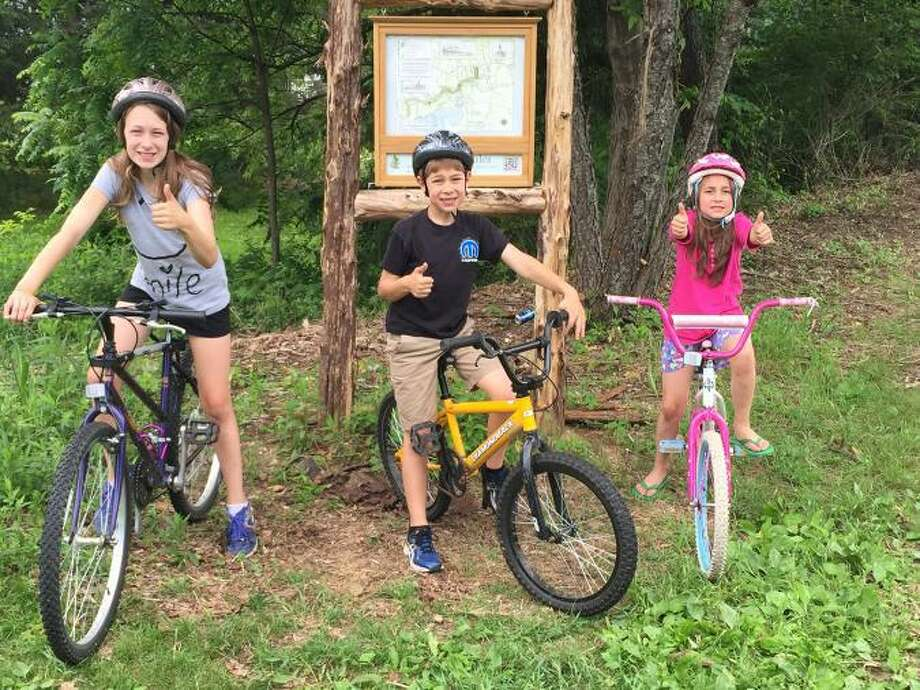 The Litchfield Community Greenway is making great progress with its trail, signage and accessibility for residents while keeping them off main roadways. Above, members of the Tranquillo family take a break during a greenway bike ride. Photo: Litchfield Community Greenway / Contributed Photo /