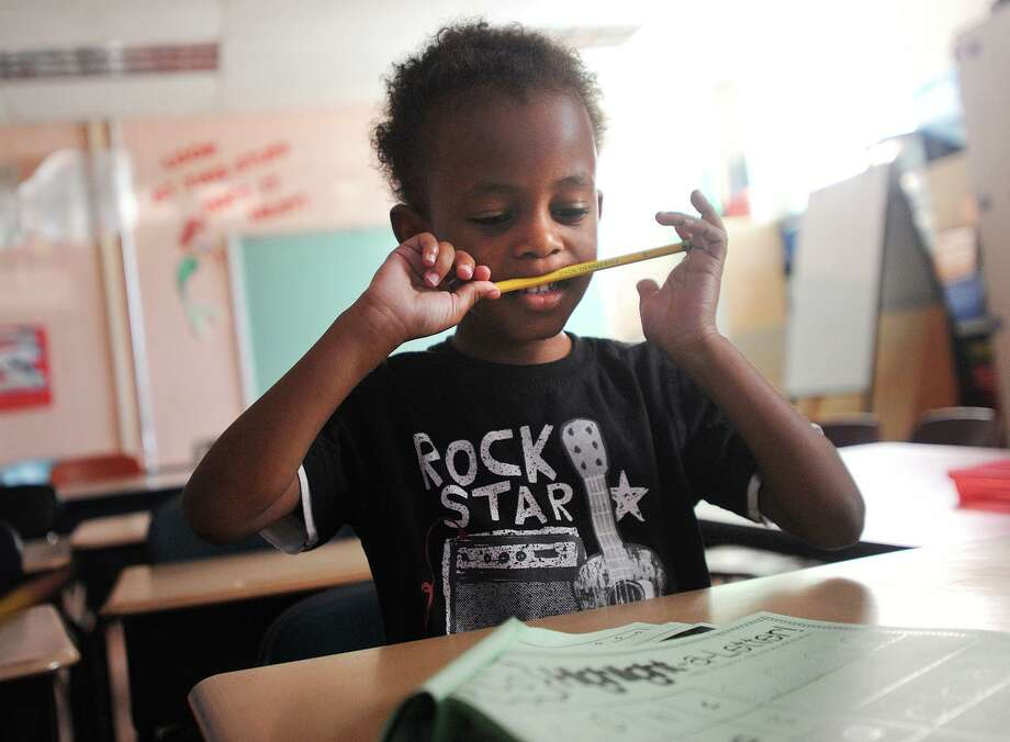 Nazir Mitchell, 4, works on his letters in his kindergarten class on the first day of the Lighthouse summer program at Luis Munoz Marin School in Bridgeport, Conn. on Wednesday, July 5, 2017. Photo: Brian A. Pounds / Hearst Connecticut Media / Connecticut Post
