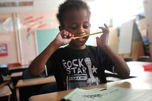 Nazir Mitchell, 4, works on his letters in his kindergarten class on the first day of the Lighthouse summer program at Luis Munoz Marin School in Bridgeport, Conn. on Wednesday, July 5, 2017.