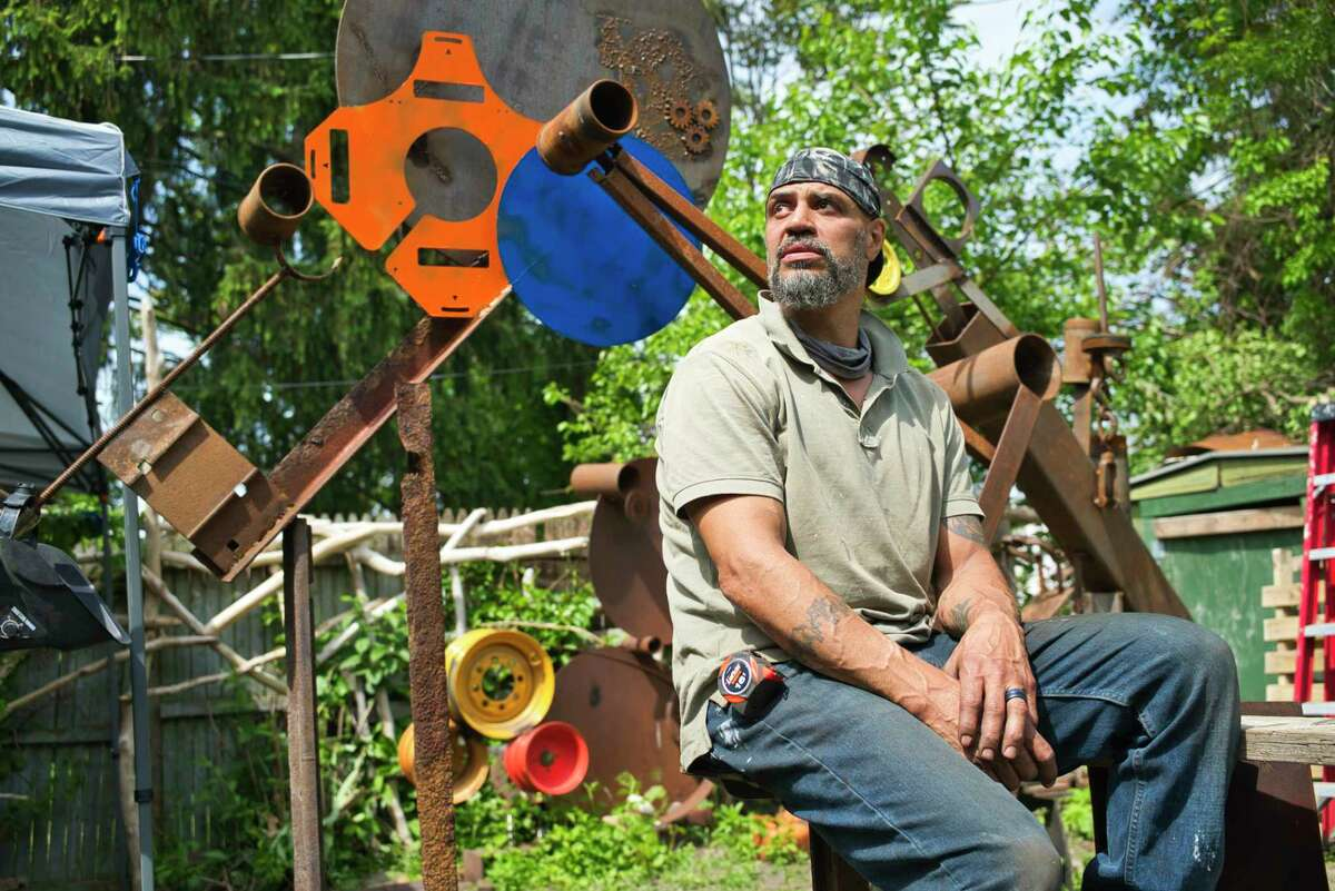 Danny Killion, owner of Weathered Wood, sits in his backyard on Tuesday, June 2, 2020, in Troy, N.Y. Killion has his store in downtown Troy. (Paul Buckowski/Times Union)