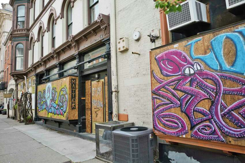 A view of boarded up windows decorated with artwork on a building on Tuesday, June 2, 2020, in Troy, N.Y. (Paul Buckowski/Times Union)