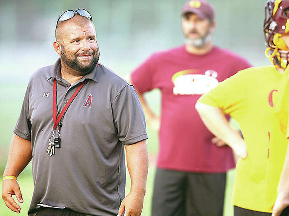 EAWR Oilers head coach Garry Herron leads his team through drills during a preseason workout in 2017. Herron and other prep football coaches in Illinois are still waiting on word from the Illinois High School Association of the state of this year's summer contact hours. Photo: Billy Hurst File Photo | For The TelegraphBilly Hurst File Photo | For The Telegraph