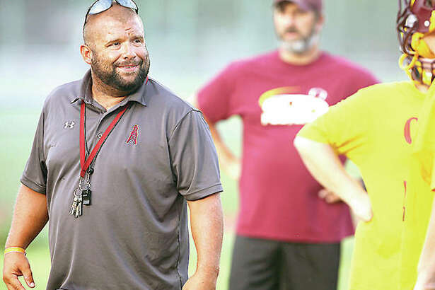 EAWR Oilers head coach Garry Herron leads his team through drills during a preseason workout in 2017. Herron and other prep football coaches in Illinois are still waiting on word from the Illinois High School Association of the state of this year's summer contact hours.