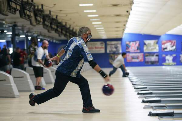 Ian Normandin warms up at Astro SuperBowl. Normandin's bowling league has split the play between teams over two nights because of COVID-19 restrictions.