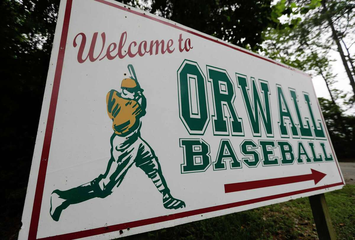 A sign welcoming visitors to the Oak Ridge Woodlands Area Little League sports fields is seen, Saturday, April 11, 2020, in Spring.