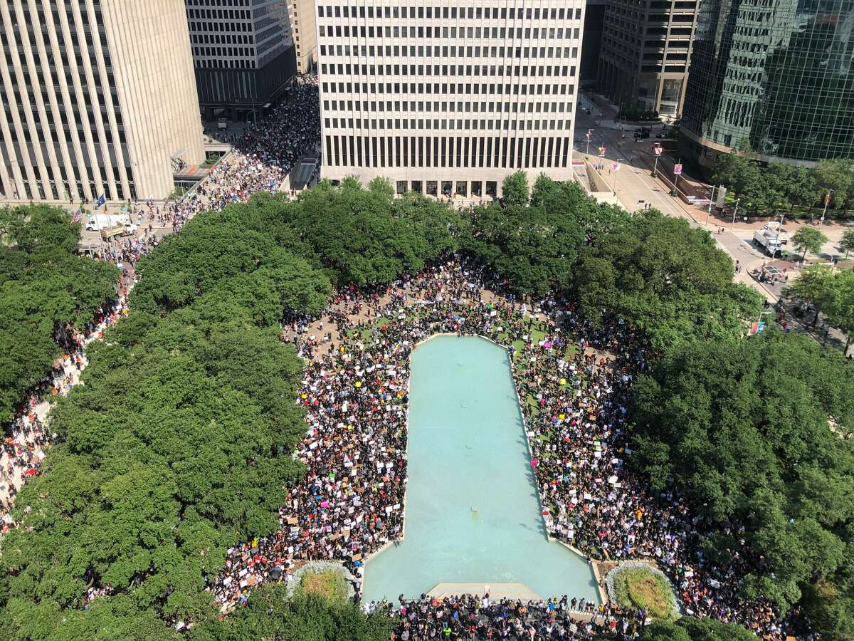 A view from the top of city hall as people join George Floyd's family in a march on Tuesday, June 2, 2020, from Discovery Green to City Hall in downtown Houston.
