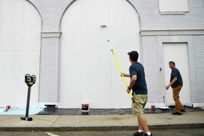 The Apple Store on Greenwich Avenue is boarded up and painted in Greenwich, Conn. Tuesday, June 2, 2020.
