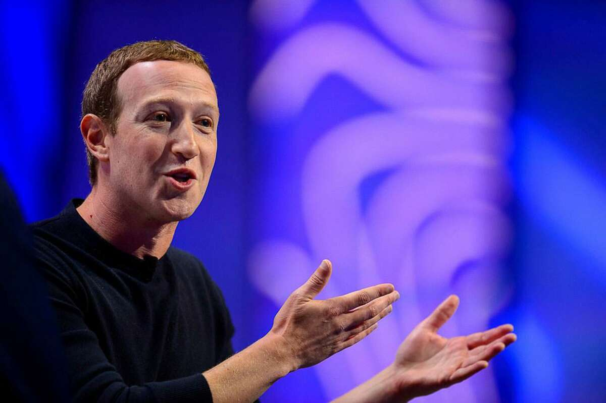 """Facebook CEO Mark Zuckerberg speaks at the Silicon Slopes Tech Summit in Salt Lake City. Zuckerberg said during the speech Friday in Utah that he doesn't want his platform to be used to """"rip society apart"""" but that at some point the social media company must stand up for free speech."""