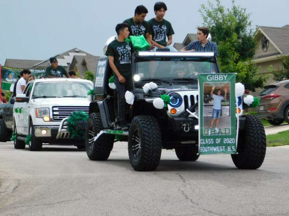 Seniors from Southwest High School and their families ride in decorated vehicles during a parade honoring the new graduates Sunday in the Solana Ridge subdivision.