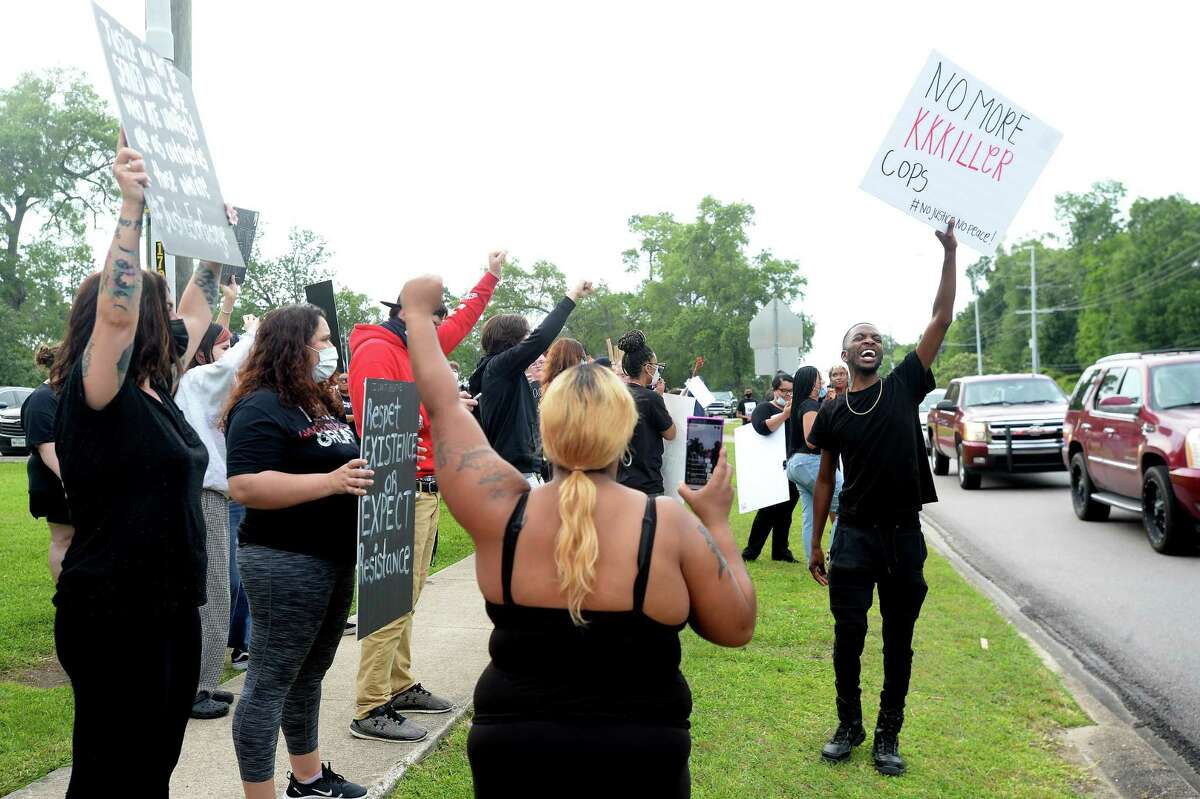 Participants join in a protest gathering for George Floyd in Rogers Park Monday. Hundreds gathered after the event, originally planned as a march from Parkdale Mall to the park, was changed due to lacking a permit to march through the high-traffic area. Families and individuals of all races joined together, carrying signs and chanting as they lined Dowlen Road along the park's edge. Passing vehicles, some holding signs outside their windows, honked and waved or held their fists in the air as they passed in a show of support. Photo taken Monday, June 1, 2020 Kim Brent/The Enterprise