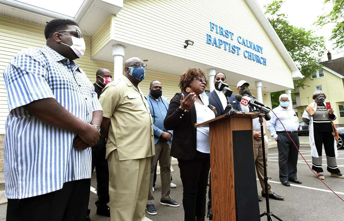 Community activist Barbara Fair of New Haven and members of the Greater New Haven Clergy Association discuss policing in black communities Tuesday during a press conference at the First Calvary Baptist Church on Dixwell Avenue in New Haven.
