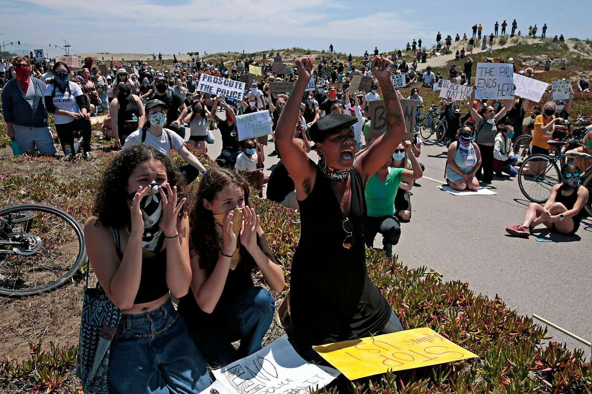 From left: Josephine Tasker, 16, her sister Tule Tasker, 12, and mother Jamae Tasker rally with hundreds of people along the Great Highway on June 2, 2020, in San Francisco, Calif. Protests in the Bay Area and the nation continued following the death of George Floyd, who died after being restrained by Minneapolis police officers on Memorial Day. Minneapolis police officer Derek Chauvin is charged with third-degree murder and second-degree manslaughter for the death of Floyd.