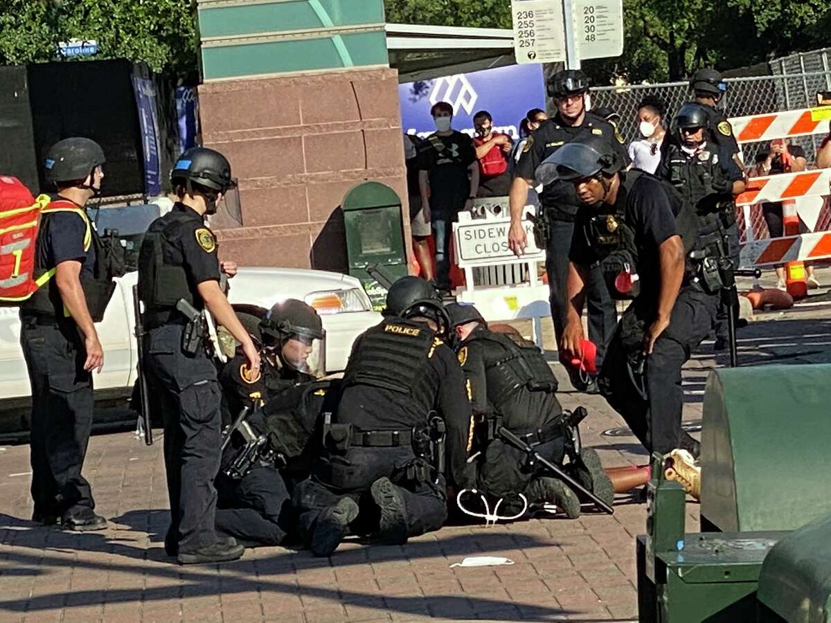 Houston police arrest a demonstrator at San Jacinto and Congress after a mostly peaceful protest in downtown Houston on June 2 to honor George Floyd.