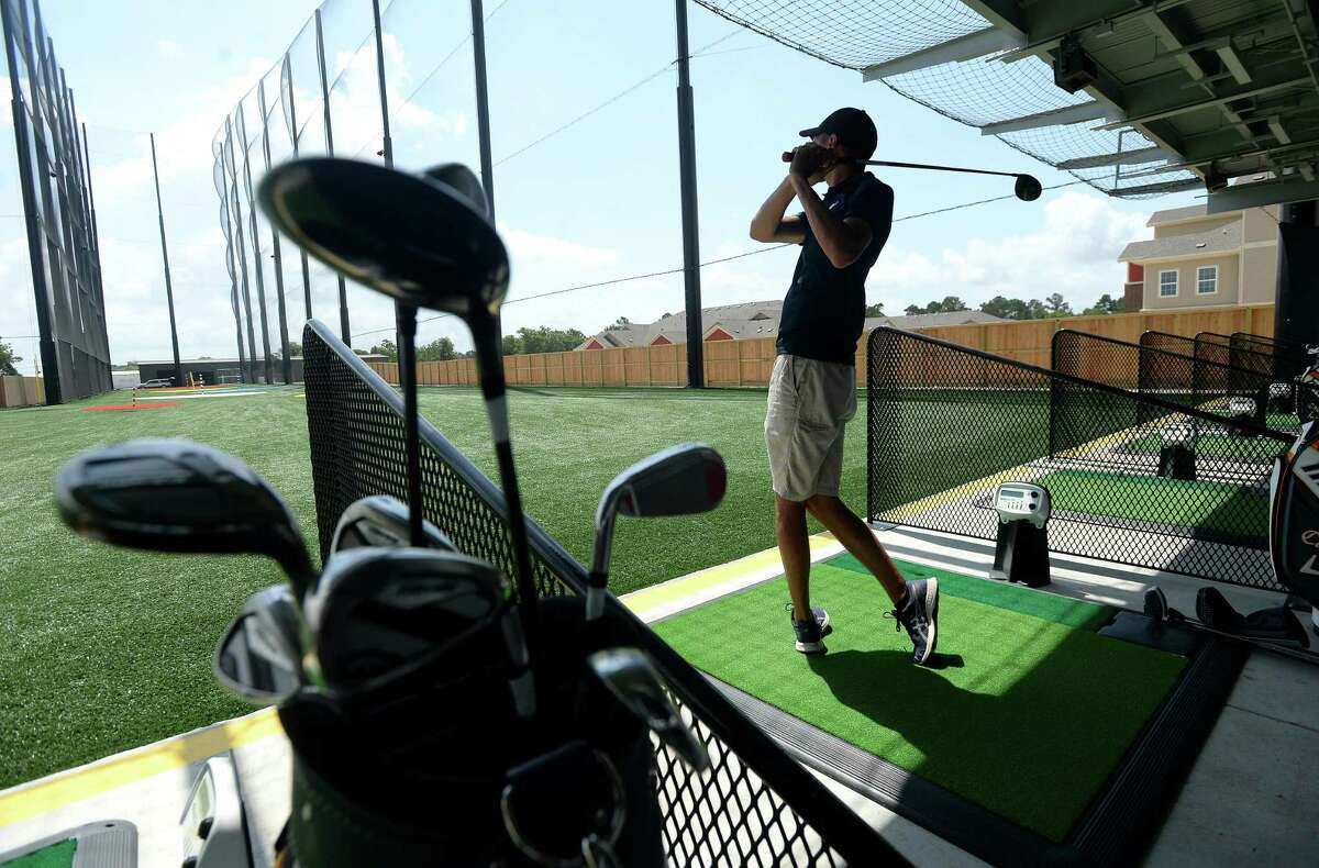 Adam Garza of Orange practices driving at 5 Under Golf Center in Beaumont Friday, May 22. He and father Ray Garza visited the establishment for the first time efore heading out to hit the links. Photo taken Friday, May 22, 2020 Kim Brent/The Enterprise