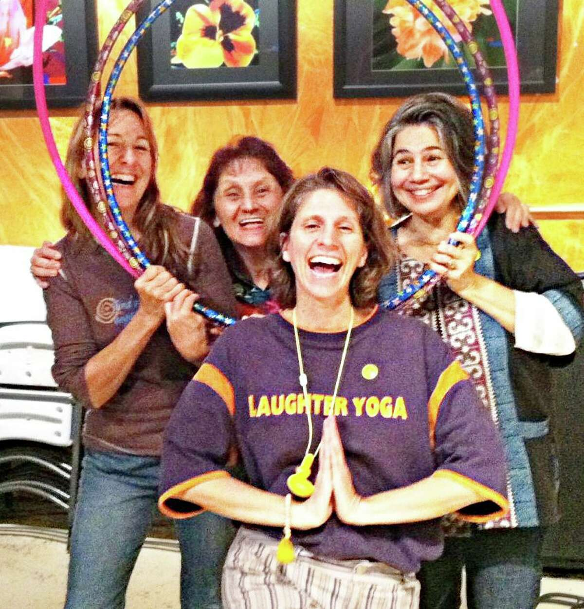 Participants in The Buttonwood Tree's Laughter Yoga program in Middletown. From left are Executive Director Anne-Marie McEwan, Flo Bartosiak, Mylène Poitras, who teaches the class, and TBT Aligned with Source leader Annaita Gandhy.