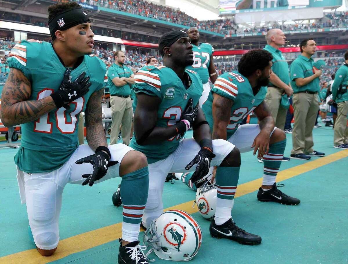 In 2016, Kenny Stills (10) and Michael Thomas (31) knelt during the national anthem in protest of police brutality against minorities. The two are now members of the Texans.
