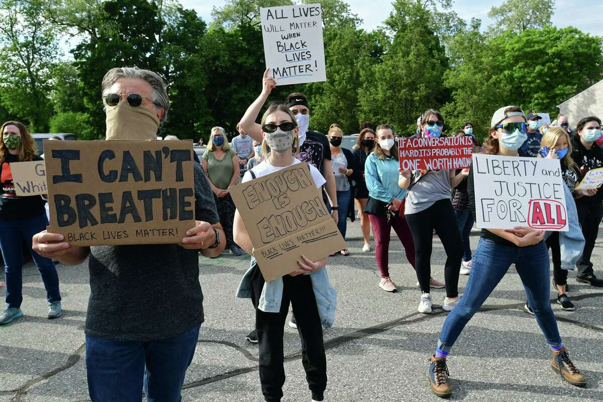 A crowd of near two hundred gather along route 7 at Our Lady of Fatima Catholic Church to protest police brutality and speak during an event at the church Tuesday, June 2, 2020, in Wilton, Conn. A march down the center of route 7 took place after the vigil at OLF in Wilton.