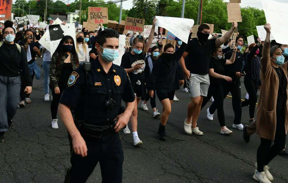 Police Capt. Rob Cipolla was among a number of Wilton officers escorting a crowd of nearly 200 along Route 7 as they marched to protest police brutality on June 2. Photo: Erik Trautmann / Hearst Connecticut Media / Norwalk Hour