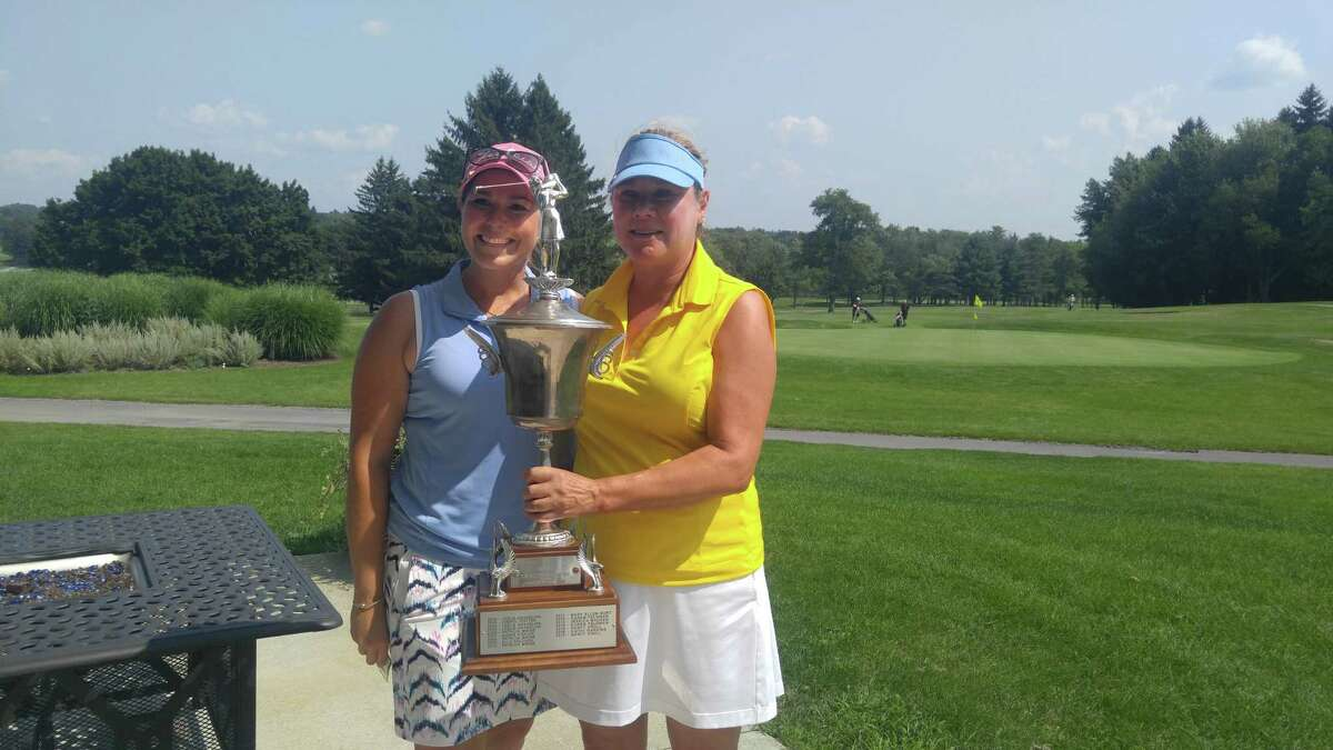 Runner-up Rachel Barlette, left, of Shaker Ridge and winner Nancy Kroll of Pinehaven after the Northeastern Women's Golf Association championship Wednesday, Aug. 15, 2018, at the Colonie Golf and Country Club. (Pete Dougherty/Times Union)
