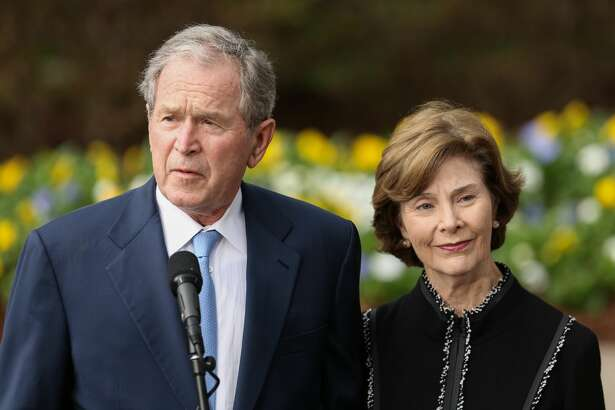 Former U.S. President George W. Bush and first lady Laura Bush address the media at The Billy Graham Library, where they paid their respect to the late Rev. Billy Graham, on Feb, 26, 2018, in Charlotte, N.C. (Logan Cyrus/AFP/Getty Images/TNS)