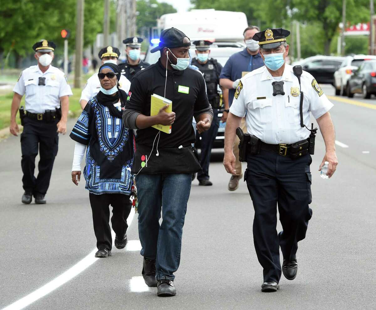 A unity march proceeds up Dixwell Avenue in Hamden on June 2, 2020 in the aftermath of the George Floyd death at the hands of Minneapolis Police.