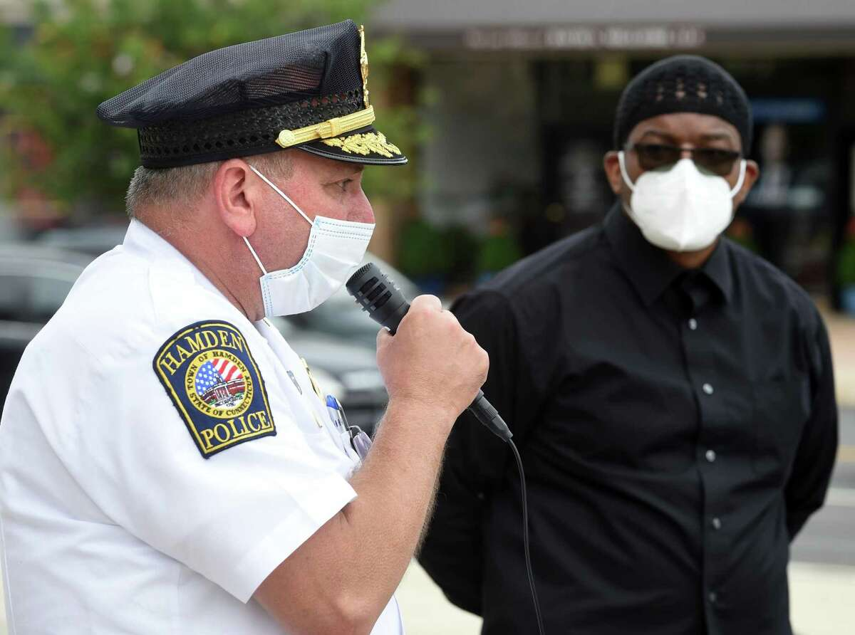 Imam Saladin Hasan of the Abdul Majid Karim Hasan Islamic Center (right) listens to Hamden Police Chief John Cappiello speak at a rally in front of Hamden Memorial Town Hall following a unity march on Dixwell Avenue on June 2, 2020 in the aftermath of the George Floyd death at the hands of Minneapolis Police.