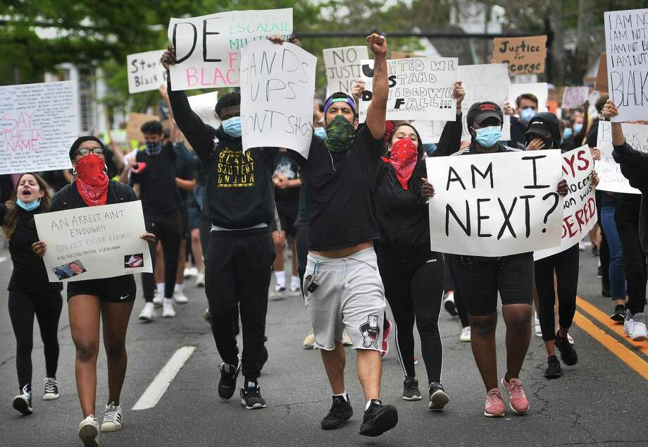 Protestors chant slogans while marching down the Post Road during an organized Black Lives Matter police brutality protest in Fairfield, Conn. on Tuesday, June 2, 2020. Photo: Brian A. Pounds / Hearst Connecticut Media / Connecticut Post