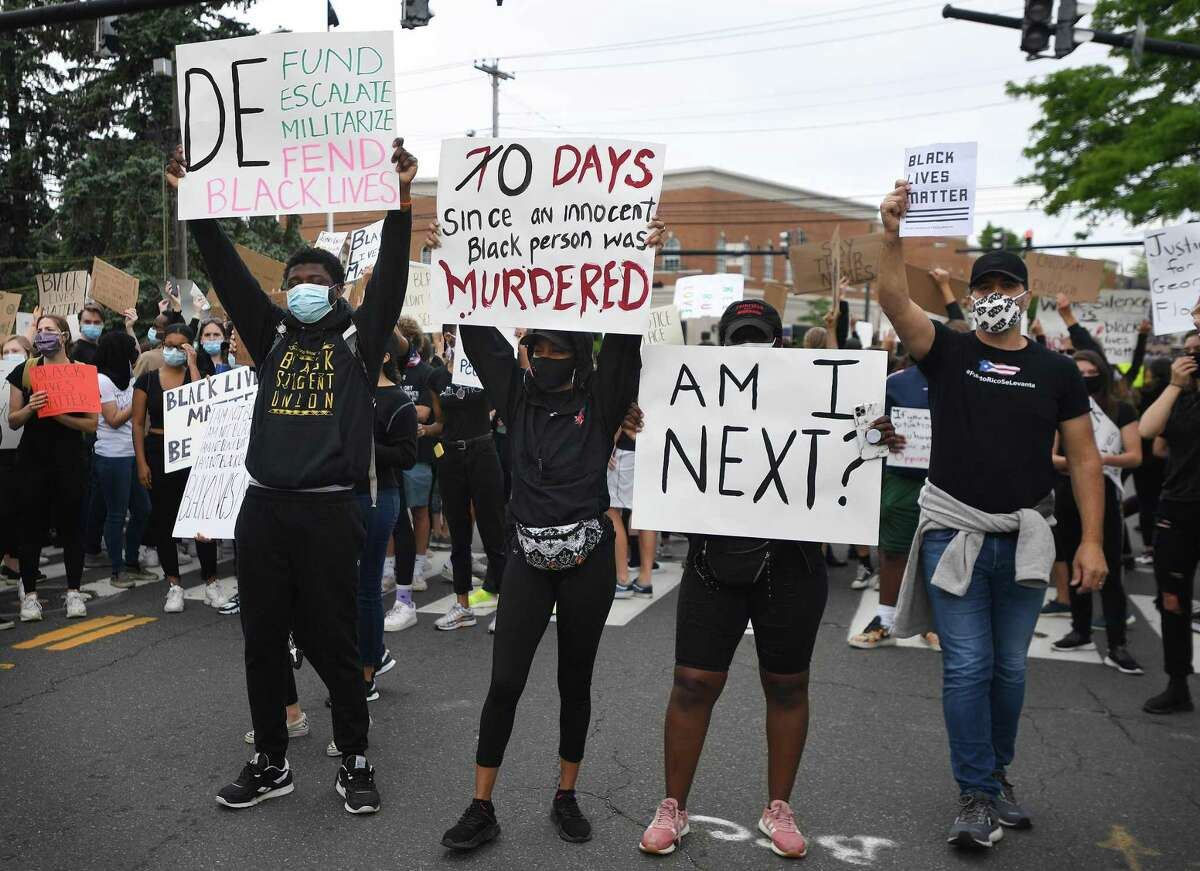 Protestors block traffic on the Post Road during an organized Black Lives Matter police brutality protest in Fairfield, Conn. on Tuesday, June 2, 2020.