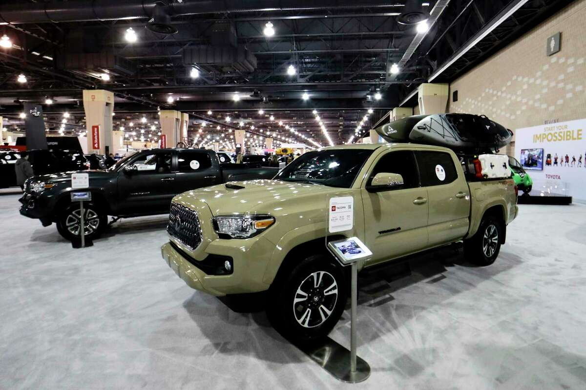 FILE- This Feb. 1, 2019, file photo shows a Toyota Tacoma at the Philadelphia Auto Show in Philadelphia. Its wide variety of configurations and well-rounded design make it a popular choice with truck shoppers. (AP Photo/Matt Slocum, File)