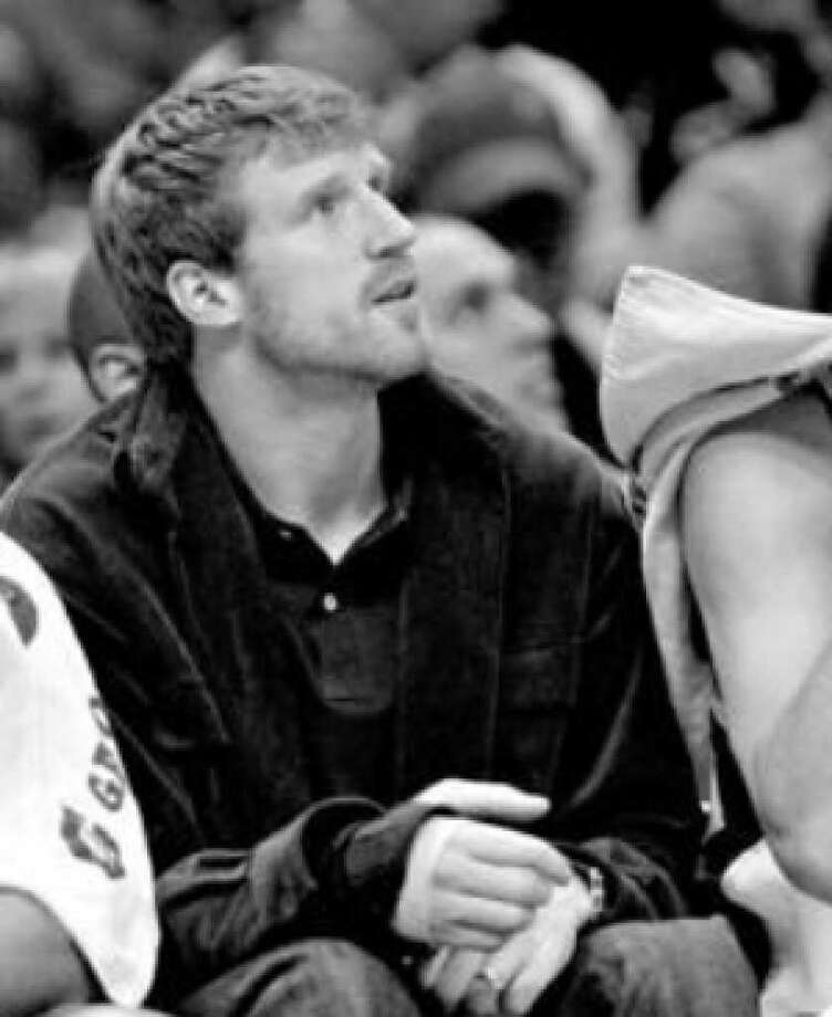 The Spurs' Matt Bonner sits on the bench after breaking a bone in his right hand in Saturday's game against the Pacers.