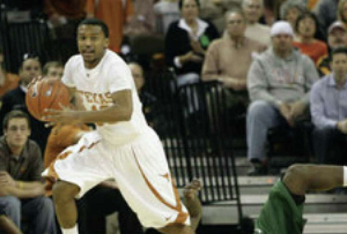 Texas' Jai Lucas moves upcourt as Michigan State's Draymond Green stays behind during the first half. Lucas had five points for the Longhorns.