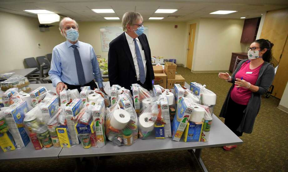 At right, Rebekah Kanefsky talks with Matt Greenberg, CEO of Jewish Family Service and Stamford Mayor David Martin during a visit to the Freedberg Family Kosher Food Pantry in Stamford, Connecticut on May 27, 2020. The food pantry, run out of the Elayne and James Schoke Jewish Family Service of Fairfield County, has been serving hundreds of families in lower Fairfield County with much needed meals, groceries, and other essential items, as well as providing mental services and counseling to those less fortunate in our community. The pantry operates three days a week and provides home delivery of prepared meals to individuals or families without transportation twice a week. The organization has partnered with the Connecticut Food Bank of Fairfield County. Photo: Matthew Brown / Hearst Connecticut Media / Stamford Advocate