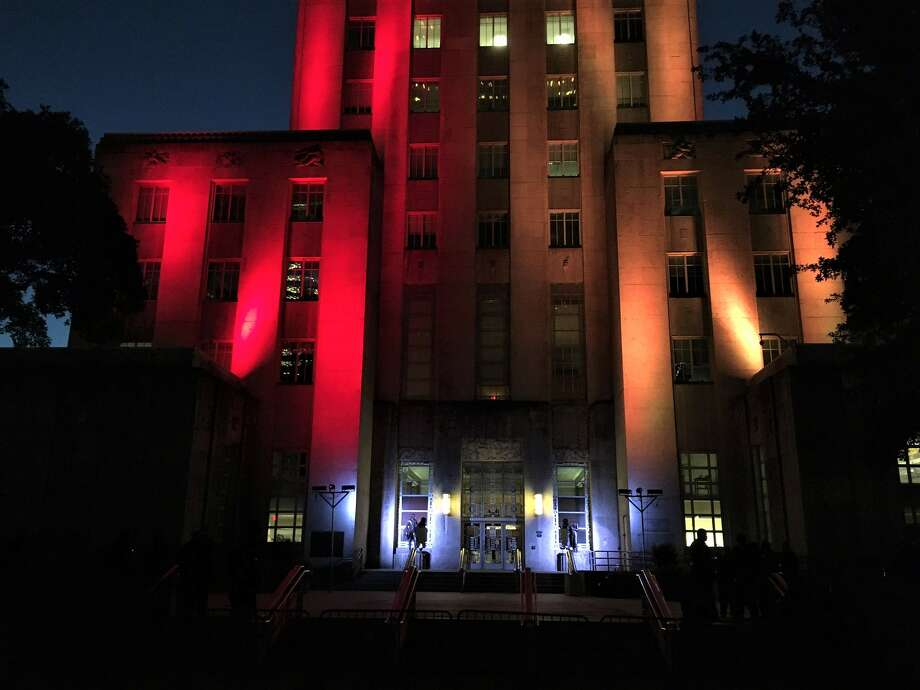 City Hall is glowing with crimson and gold lights. Photo:St. John Barned-Smith Photo: St. John Barned-Smith