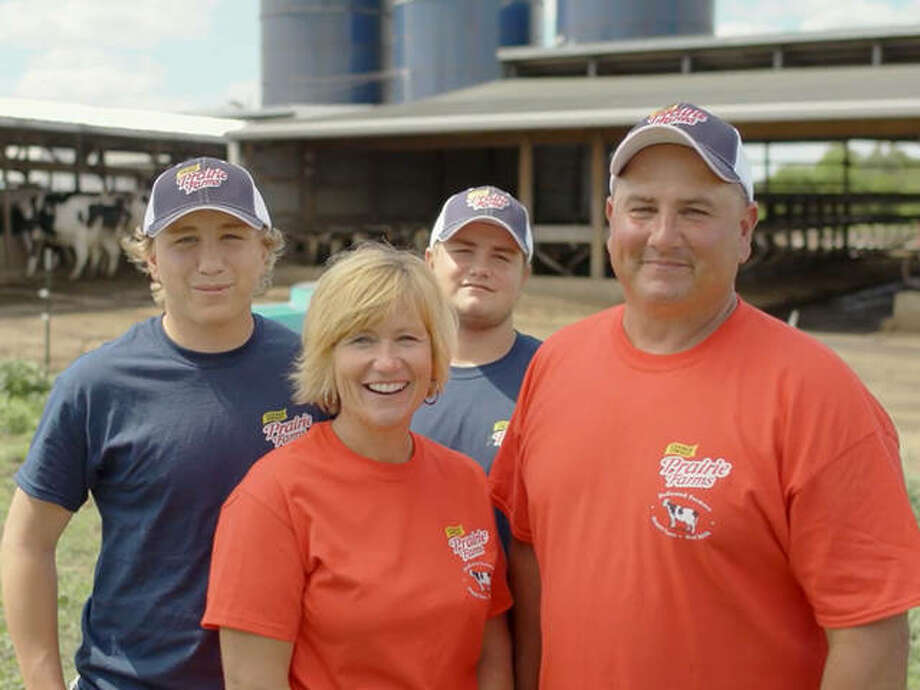 Frank Doll, right, of Pocahontas, is a dedicated family farmer with farmer-owned Prairie Farms, headquartered in Edwardsville. At any given day on his farm, you could find not only him working in the barns, but also his father, wife Pam, and two sons, Logan and Blake. Photo: Courtesy Of Prairie Farms For The Telegraph