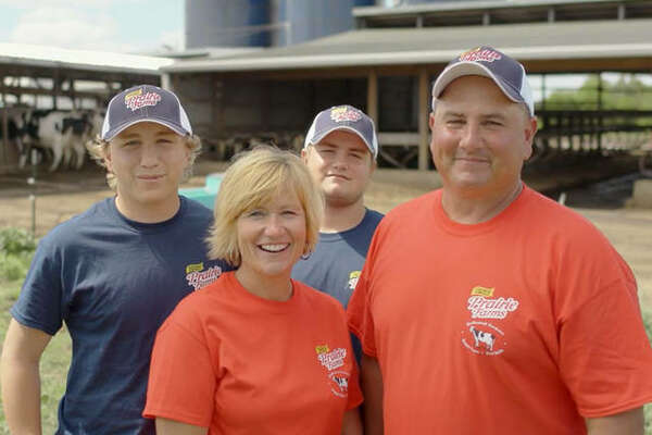 Frank Doll, right, of Pocahontas, is a dedicated family farmer with farmer-owned Prairie Farms, headquartered in Edwardsville. At any given day on his farm, you could find not only him working in the barns, but also his father, wife Pam, and two sons, Logan and Blake.
