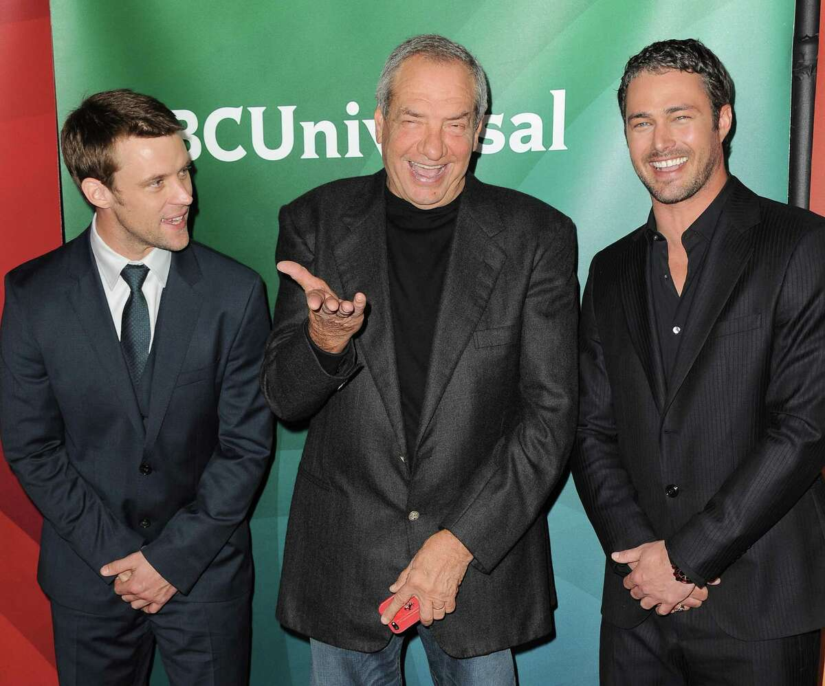 From left, Jesse Spencer, Dick Wolf and Taylor Kinney of NBC's