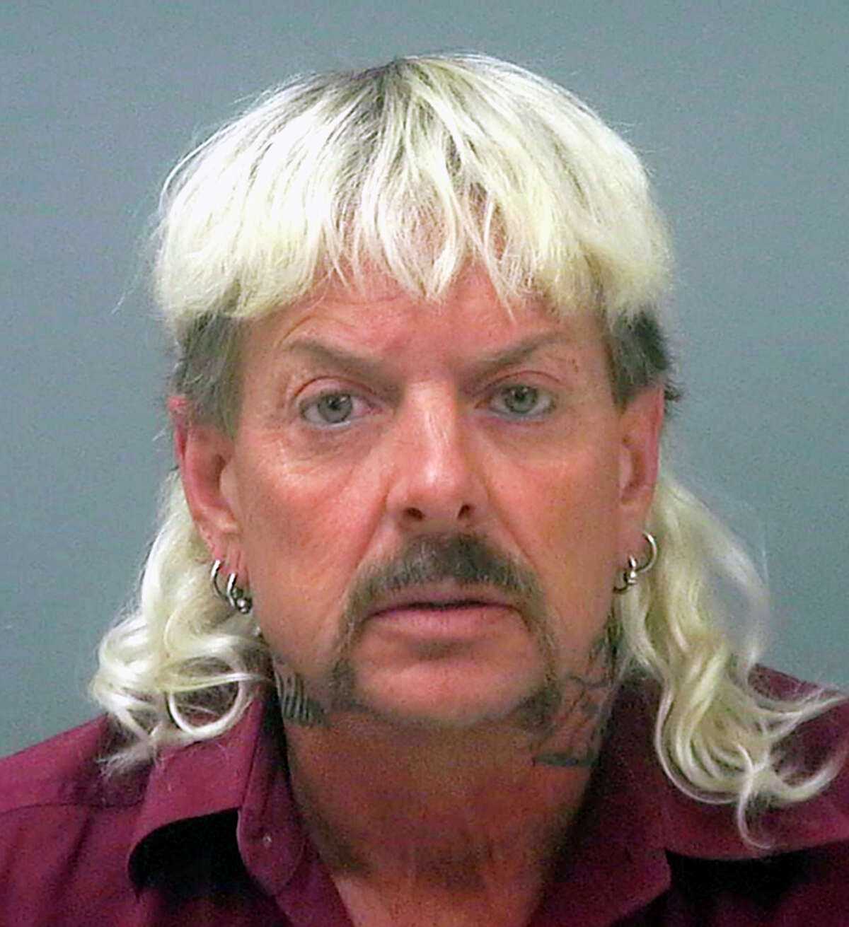 FILE - This undated file photo provided by the Santa Rose County Jail in Milton, Fla., shows Joseph Maldonado-Passage, also known as Joe Exotic. A federal judge in Oklahoma has awarded ownership of the zoo made famous in Netflix's a€œTiger Kinga€ docuseries to Joe Exotic's rival, Carole Baskin. In a ruling Monday, June 1, 2020, U.S. District Judge Scott Palk granted control of the Oklahoma zoo that was previously run by Joseph Maldonado-Passage a€?