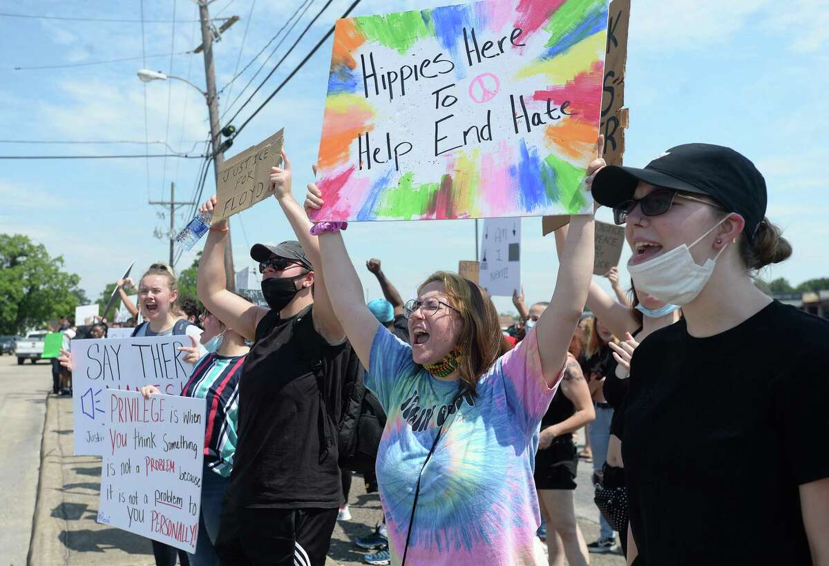 Participants, including Kailey Lewis (tye dye), join in a protest gathering for George Floyd in a lot at the cornner of Concord and Lucas Tuesday afternoon. The large crowd carried signs and chanted as they lined the roadway, receiving honks of support from passing cars, several of whom pulled into the lot to watch or join in the protest. Nearly a diozen police cars sat at one end of the lot to monitor the situation, officers briefly gathering in a line as the protesters marched around the lot and past where they were assembled several yards away. Photo taken Tuesday, June 2, 2020 Kim Brent/The Enterprise
