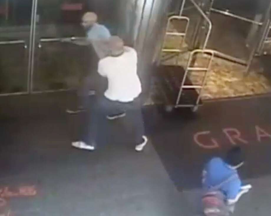 """This image taken from a surveillance camera and released by the New York Police Department shows former tennis star James Blake, top left, being arrested by plainclothes officer James Frascatore outside of the Grand Hyatt New York hotel on Wednesday, Sept. 9, 2015, in New York. Blake was mistaken for an identity-theft suspect that Police Commissioner William Bratton said looked like Blake's """"twin."""" Bratton apologized to Blake. (NYPD via AP) Photo: Associated Press"""