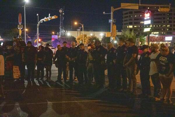 Protestors and Midland Police Officers pray together on Tuesday, June 2, 2020 on the corner of Louisiana Avenue and Big Spring Street.