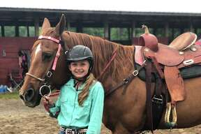 Kristin Ulrich shows horses and is part of Stanwood Pioneers.