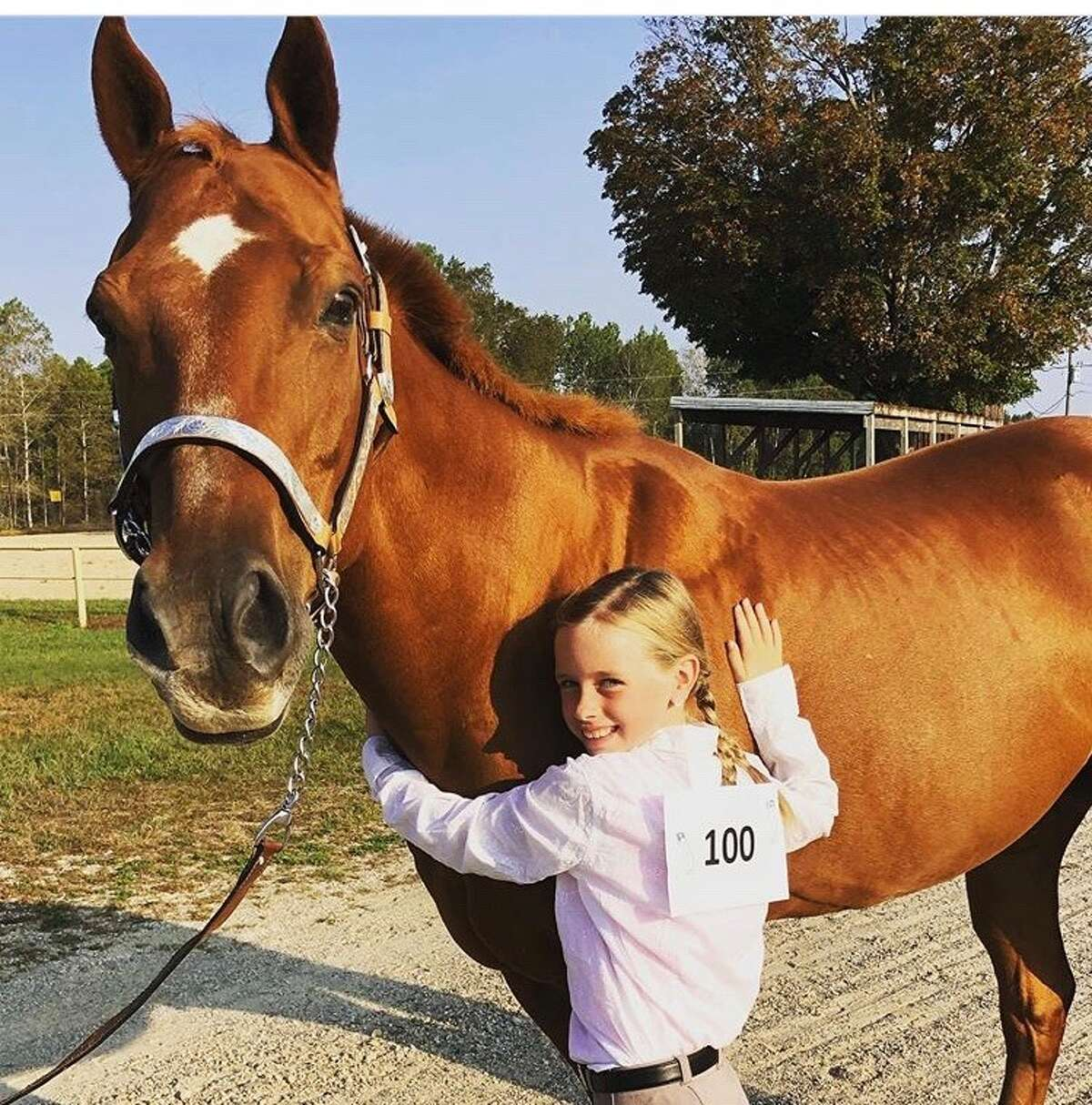 Ellaina Malloy (10) with Oscar. This would have been her first year showing with Barnyard Bunch.