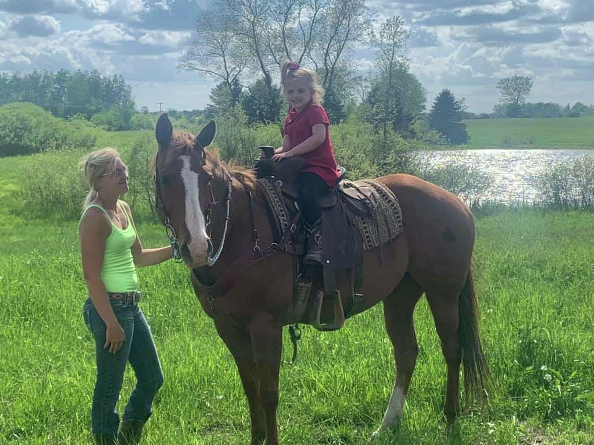 Haydin Ellison with her horse Jo Jo. She is part of The Barnyard Bunch. Would of been her first year at fair.