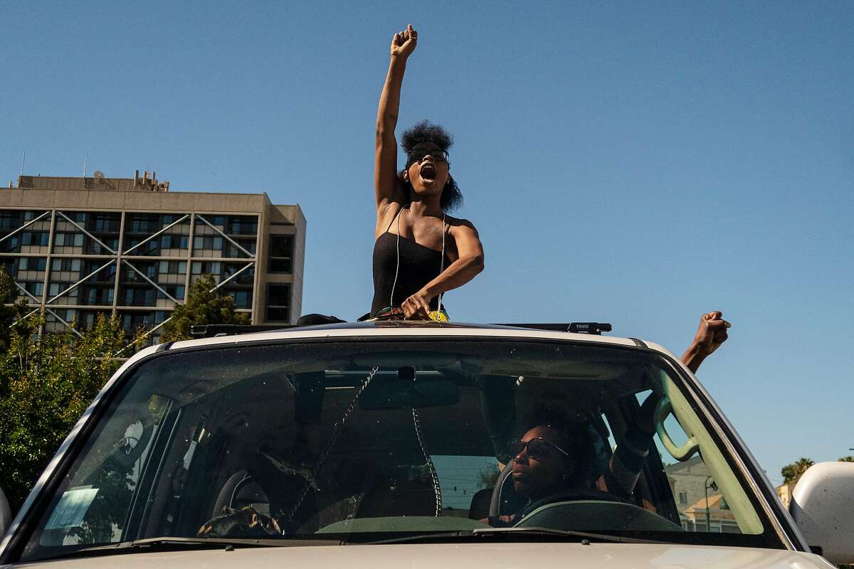 Demonstrators raise their fists during a protest march following the death in Minnesota of George Floyd held Vallejo, Calif., Tuesday, June 2, 2020.