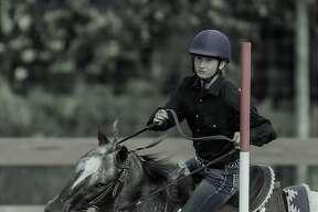 Kara Veltema - Hats to Hooves. Kara shows a pony.