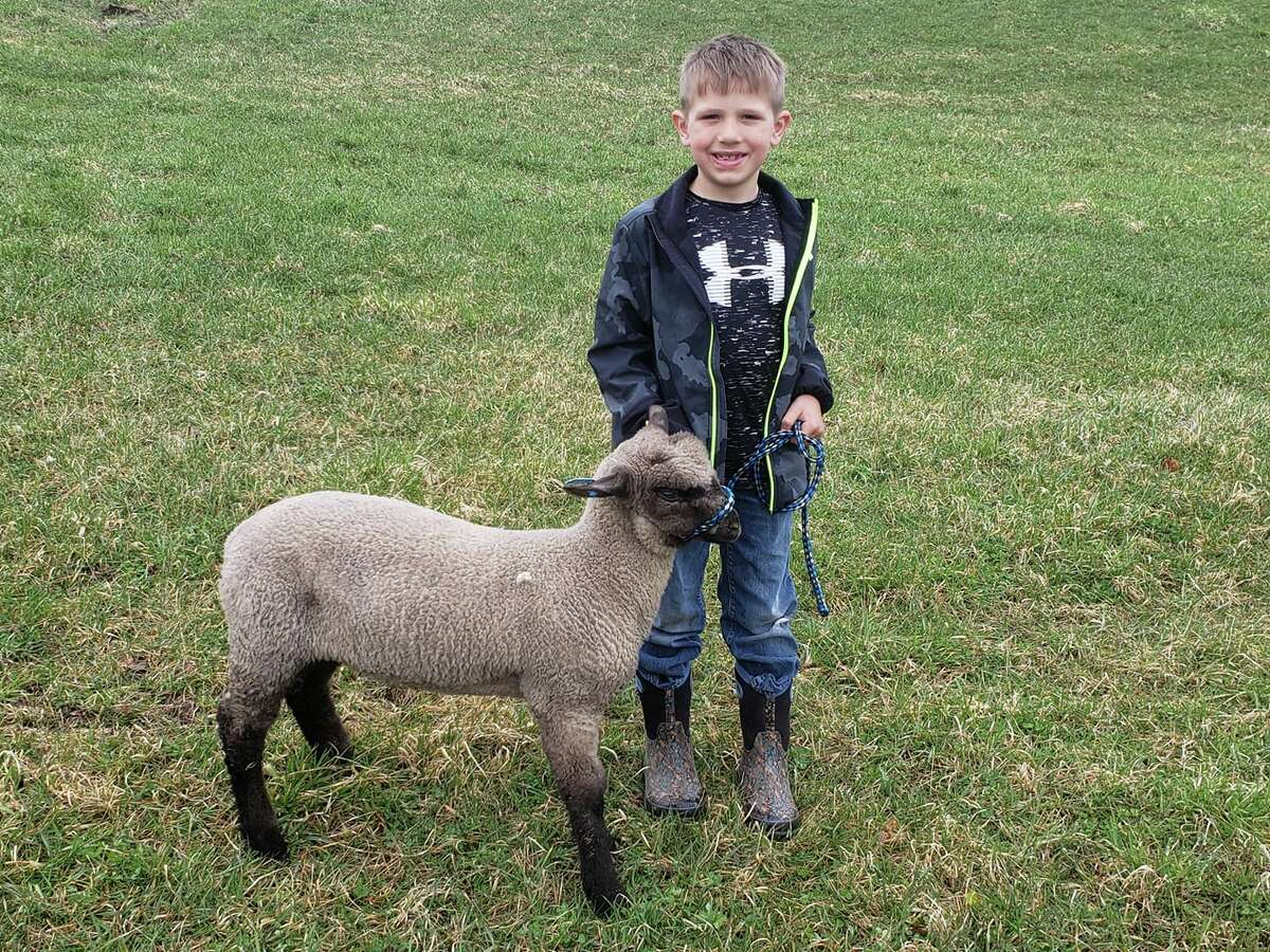 Hudson Zimmerman with his sheep Buck. Boots and Country Roots.