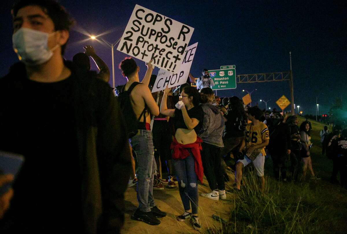 Demonstrators stand on the hill next to U.S. Highway 281-South during a demonstration in downtown San Antonio, Texas, on June 2, 2020. Local activist groups planned another protest of the death of George Floyd, a Minneapolis man who died in the custody of a Minneapolis police officer May 25.