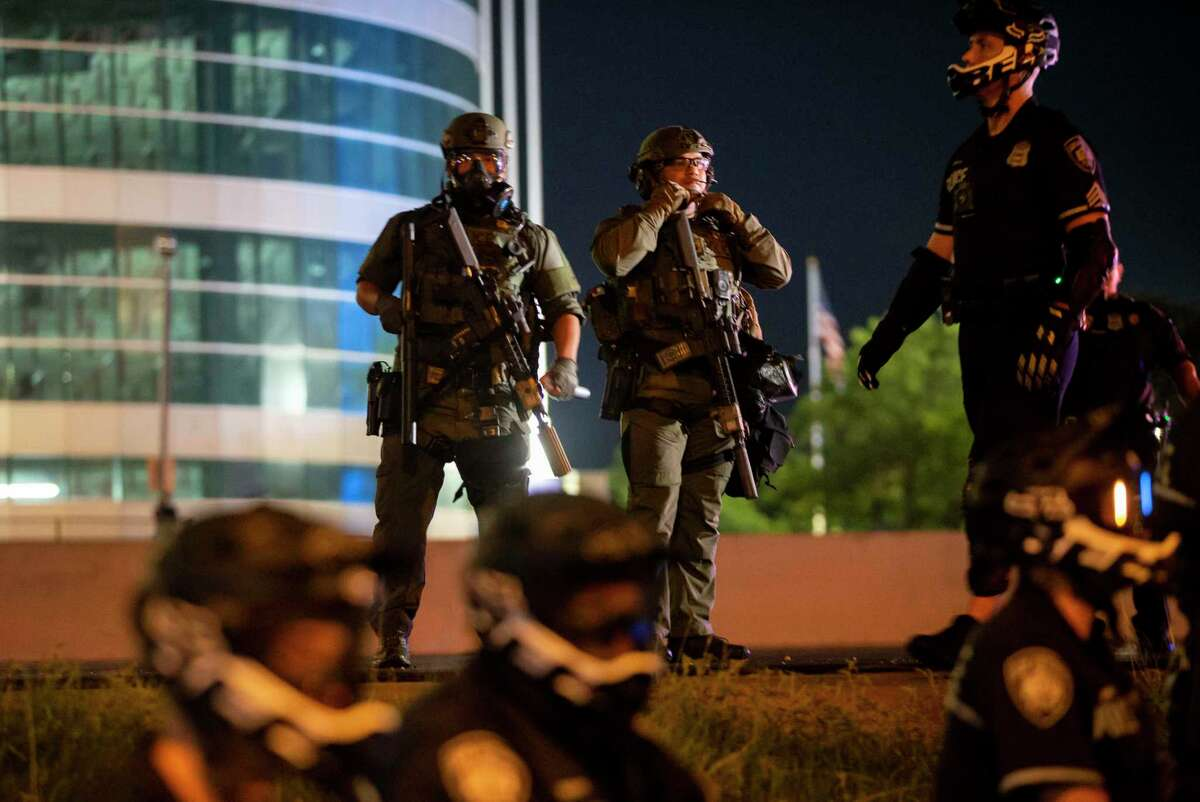 Police officers gear up in front of demonstrators in downtown San Antonio, Texas, on June 2, 2020. Local activist groups planned another protest of the death of George Floyd, a Minneapolis man who died in the custody of a Minneapolis police officer May 25.