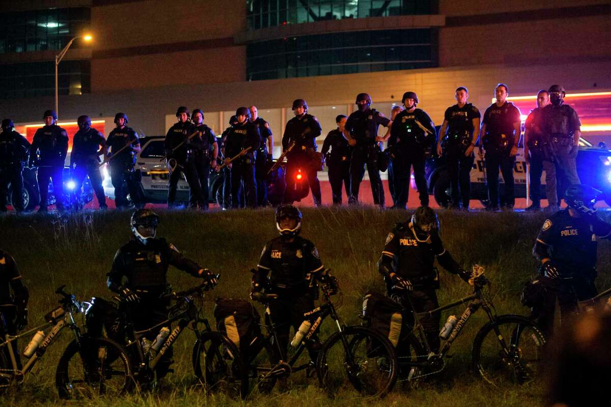 Members of law enforcement gather on the hill on the side of U.S. Highway 281 in response to a demonstration in downtown San Antonio, Texas, on June 2, 2020. Local activist groups planned another protest of the death of George Floyd, a Minneapolis man who died in the custody of a Minneapolis police officer May 25.